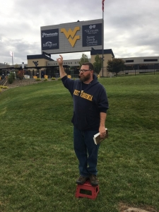 Eric Madia preaching at WVU game