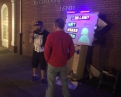 Jaycen doing sketch evangelism by blacklight